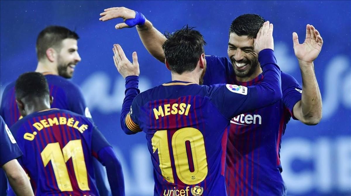 Messi y Súarez celebrando un gol.