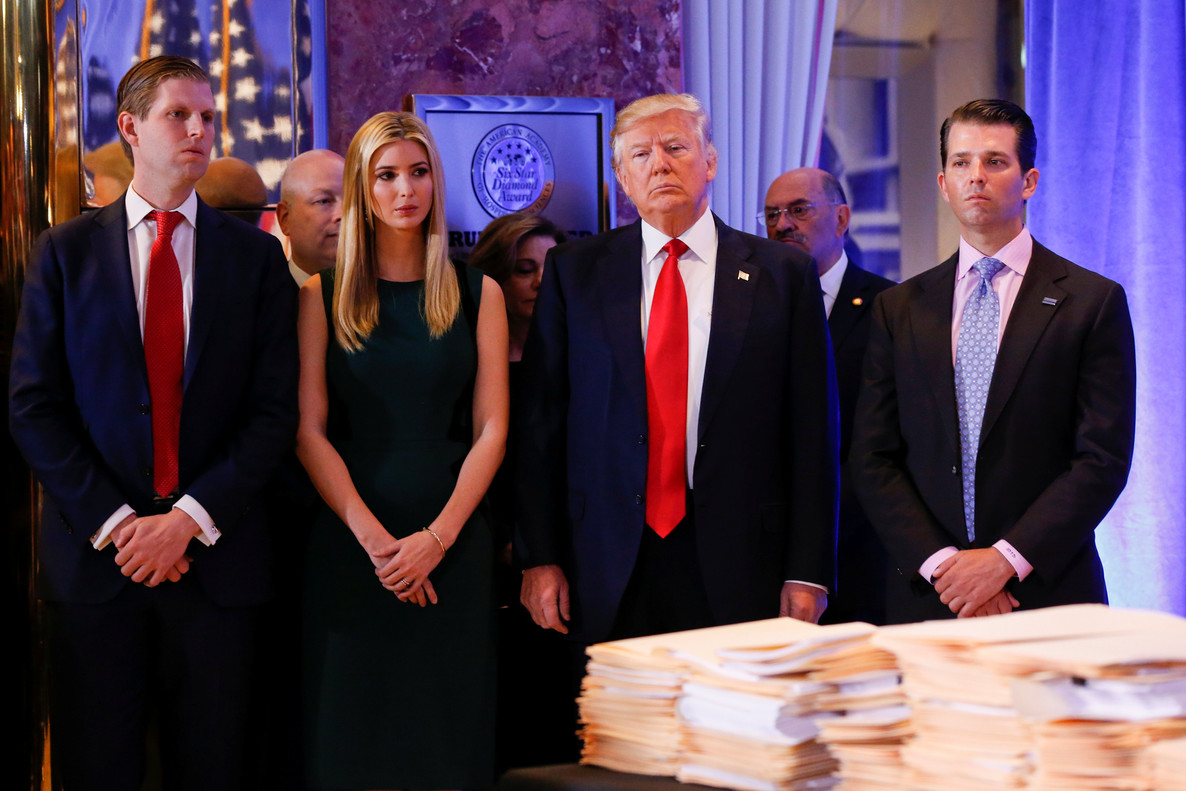 REFILE - CORRECTING ID FOR PERSON ON THE RIGHT. U.S. President-elect Donald Trump (C) stands surrounded by his son Eric Trump (L) daughter Ivanka and son Donald Trump Jr. (R) ahead of a press conference in Trump Tower, Manhattan, New York, U.S., January 11, 2017. REUTERS/Shannon Stapleton TPX IMAGES OF THE DAY
