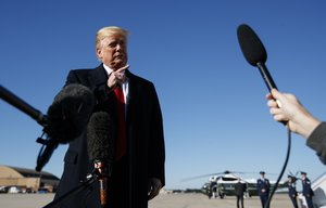 President Donald Trump talks to reporters as before boarding Air Force One  in Andrews Air Force Base  Md   en route to campaign stops in Montana  Arizona and Nevada   AP Photo Carolyn Kaster