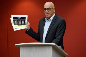 Venezuelas Minister of Communication Jorge Rodriguez shows pictures of detainee during a press conference  at the Miraflores presidential palace in Caracas. Venezuela accuses diplomats of supporting the failed escape of those accused for an attack against President Nicolas Maduro   Photo by Federico PARRA   AFP