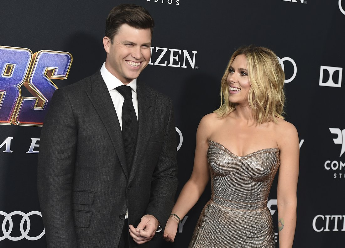FILE - In this April 22, 2019, file photo, Colin Jost, left, and Scarlett Johansson arrive at the premiere of Avengers: Endgame at the Los Angeles Convention Center. Wedding bells are in the future for actress Scarlett Johansson and Saturday Night Live's Colin Jost. Johansson's publicist Marcel Pariseau tells The Associated Press Sunday, May 19, 2019, that the private couple is officially engaged after two years of dating. Pariseau says no date has been set for the nuptials. (Photo by Jordan Strauss/Invision/AP, File)