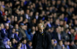 Soccer Football - FA Cup Fifth Round - Wigan Athletic vs Manchester City - DW Stadium, Wigan, Britain - February 19, 2018 Manchester City manager Pep Guardiola looks dejected REUTERS/Andrew Yates