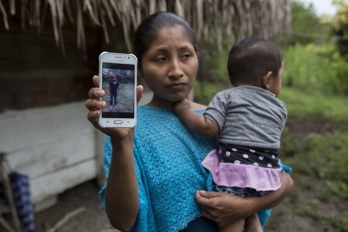 Claudia Maquin  27  shows a photo of her daughter  Jakelin Amei Rosmery Caal Maquin in Raxruha  Guatemala.  The 7-year-old girl died in a Texas hospital  two days after being taken into custody by border patrol agents in a remote stretch of New Mexico desert   AP Photo Oliver de Ros
