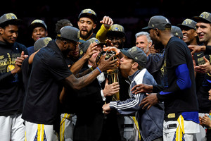 Jun 8, 2018; Cleveland, OH, USA; Golden State Warriors owner Peter Guber kisses the Larry O'Brien Championship Trophy after beating the Cleveland Cavaliers in game four of the 2018 NBA Finals at Quicken Loans Arena. Mandatory Credit: Kyle Terada-USA TODAY Sports TPX IMAGES OF THE DAY