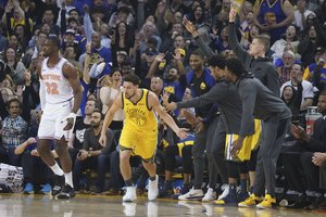 January 8, 2019; Oakland, CA, USA; Golden State Warriors guard Klay Thompson (11) is congratulated for scoring a three-point basket against New York Knicks forward Noah Vonleh (32) during the first quarter at Oracle Arena. Mandatory Credit: Kyle Terada-USA TODAY Sports