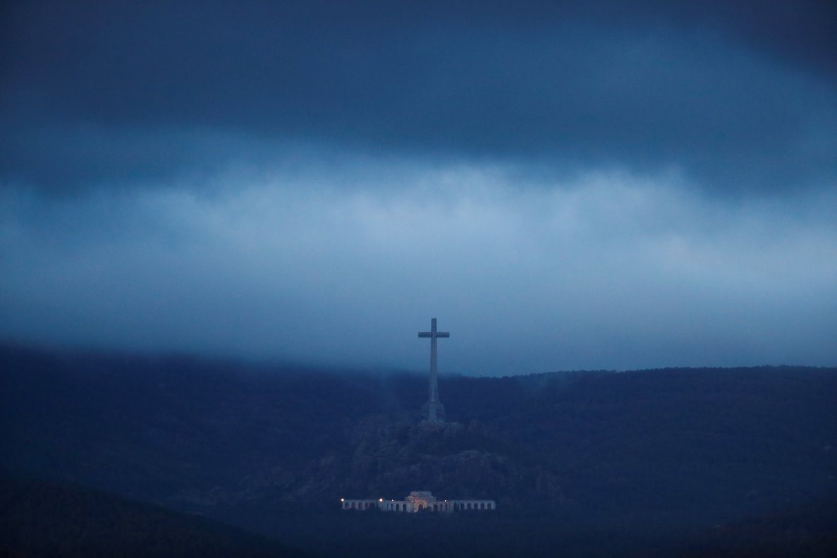 The Valle de los Caidos (The Valley of the Fallen), the state mausoleum where late Spanish dictator Francisco Franco is buried, is seen at dusk in San Lorenzo de El Escorial in this picture taken from Guadarrama, near Madrid, Spain, October 24, 2019. REUTERS/Sergio Perez