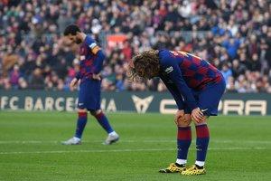 Griezman y Messi, tras perder una ocasión de gol ante el Getafe