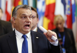 Hungarys Prime Minister Viktor Orban reacts as he leaves a European Union leaders summit in Brussels, Belgium December 18, 2015. REUTERS/Francois Lenoir