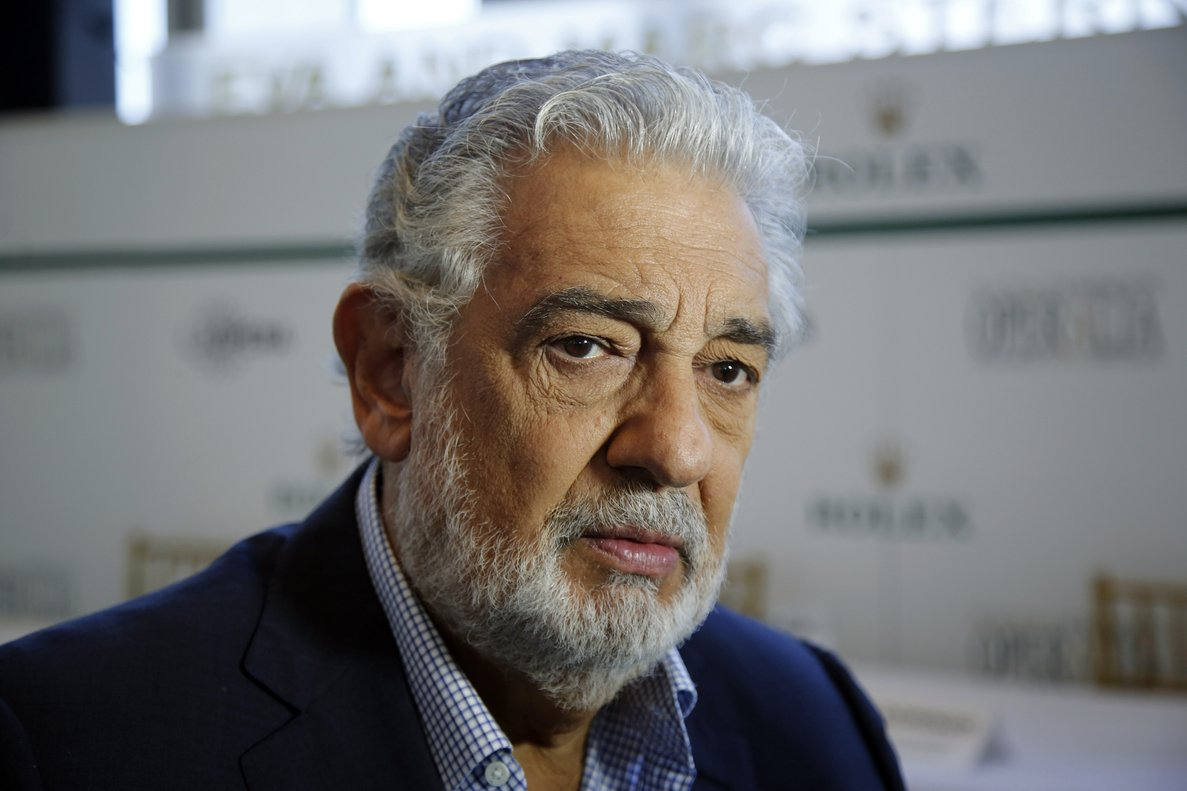 FILE - In this Aug. 26, 2014, file photo, Placido Domingo speaks at the Dorothy Chandler Pavilion in Los Angeles. LA Opera has named former United States Attorney Debra Wong Yang on Tuesday, Aug. 20, 2019, to lead an âindependent investigationâ into allegations of sexual harassment against Domingo. The investigation into Domingoâs behavior follows an Associated Press report detailing multiple accusations against the opera star. (AP Photo/Damian Dovarganes, File)