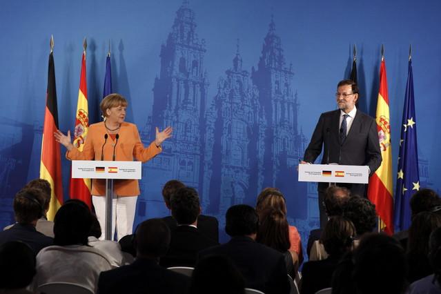 Rajoy y Merkel dan una rueda de prensa conjunta en Santiago, el pasado 25 de agosto.