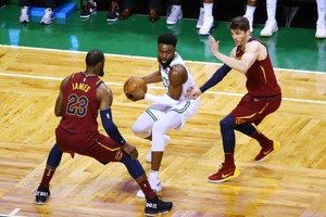 BOSTON, MA - MAY 13: Jaylen Brown #7 of the Boston Celtics is defended by LeBron James #23 and Kyle Korver #26 of the Cleveland Cavaliers during the first quarter in Game One of the Eastern Conference Finals of the 2018 NBA Playoffs at TD Garden on May 13, 2018 in Boston, Massachusetts. Adam Glanzman/Getty Images/AFP