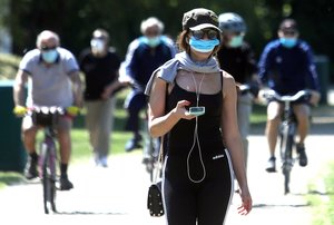 Milan (Italy), 07/05/2020.- A girl walking at the Idroscalo park which is reopening to the public today in Milan, Italy, 07 May 2020. Starting from 04 May 2020 Italy have entered the second phase of relaxing coronavirus lockdown measures. (Abierto, Italia) EFE/EPA/MATTEO BAZZI