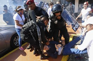 An anti-government protester is dragged away and arrested by police as security forces disrupt an opposition march coined  United for Freedom  in Managua  Nicaragua.   AP Photo Alfredo Zuniga