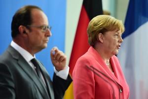 Merkel i Hollande en la compareixença posterior a laseva trobadadaquest dilluns a Berlín.