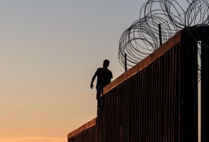A man stands on the US-Mexico border wall for fun in Playas de Tijuana  northwestern Mexico  - He came  he disrupted  he declared victory.   Photo by Guillermo Arias   AFP