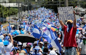 An anti-government protester holds a sign that reads Police have betrayed your people during a protest against Nicaraguan President Daniel Ortega s government in Managua Nicaragua September 16 2018 REUTERS Oswaldo Rivas