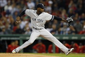 FILE - In this Sept. 6, 2019, file photo, New York Yankees' Domingo German pitches during the first inning of the team's baseball game against the Boston Red Sox, in Boston. Yankees pitcher Domingo German will miss the first 63 games of the 2020 season as part of an 81-game ban for violating Major League Baseballâs domestic violence policy. The league announced the suspension Thursday, Jan. 2, 2020. German has agreed not to appeal. (AP Photo/Michael Dwyer, File)