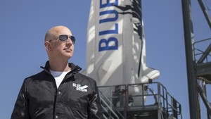 This April 24, 2015 handout photograph obtained courtesy of Blue Origin shows Jeff Bezos, founder of Blue Origin, at New Shepards West Texas launch facility before the rockets maiden voyage.
