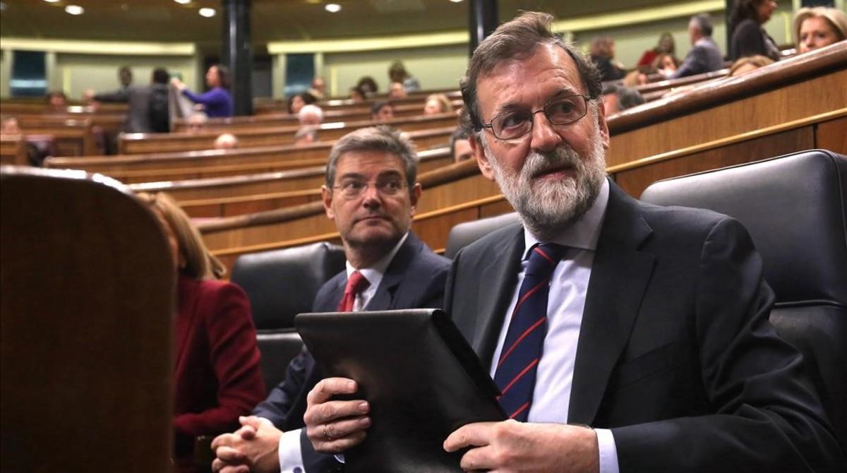 Mariano Rajoy, junto a Rafael Catalá, en el Congreso