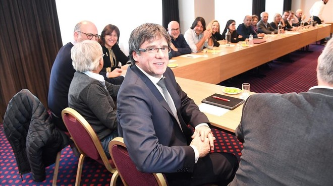 undefined41919119 former catalan leader carles puigdemont looks on as he meets180215114526