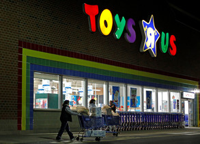 FILE PHOTO: Consumers leave a Toys R Us store with full shopping carts after shopping on the day dubbed Black Friday in Framingham, Massachusetts, U.S., November 25, 2011. REUTERS/Adam Hunger/File Photo