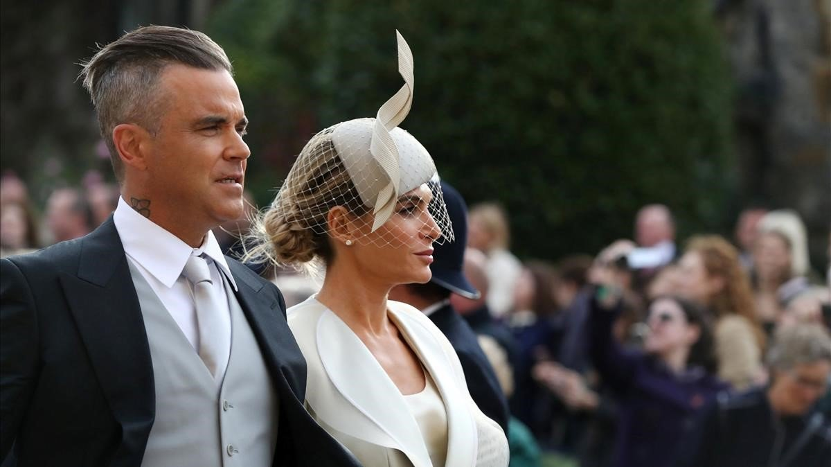Robbie Williams y Ayda Field, a su llegada a la boda.