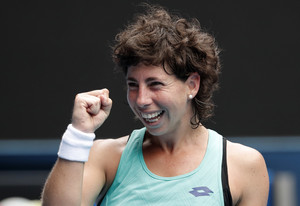 Spains Carla Suarez Navarro celebrates after defeating Anett Kontaveit of Estonia in their fourth round match at the Australian Open tennis championships in Melbourne, Australia Sunday, Jan. 21, 2018. (AP Photo/Vincent Thian)