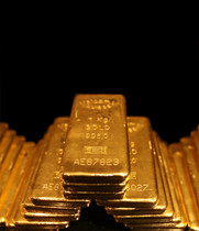 La imagen muestra lingotes de oro.