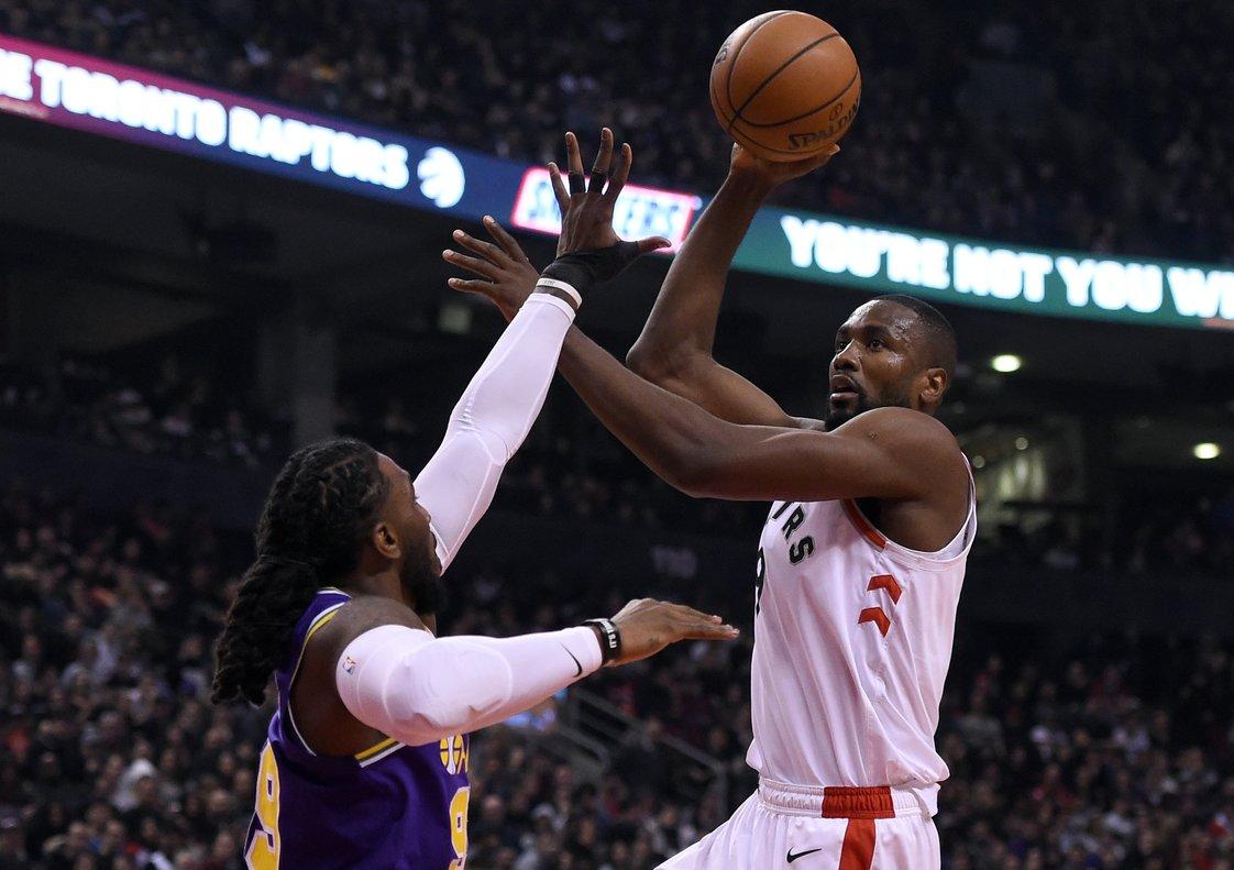 Jan 1, 2019; Toronto, Ontario, CAN; Toronto Raptors center Serge Ibaka (9) shoots for a basket over Utah Jazz forward Jae Crowder (99) in the first half at Scotiabank Arena. Mandatory Credit: Dan Hamilton-USA TODAY Sports