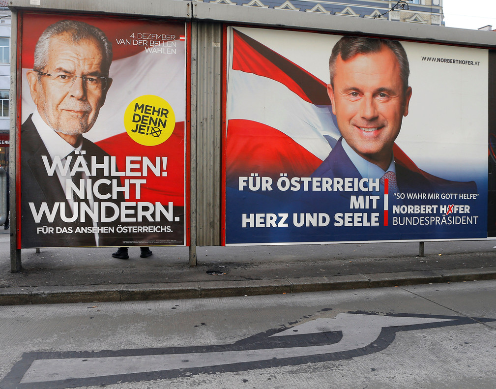 Presidential election campaign posters of Alexander Van der Bellen (L), who is supported by the Greens, reading Vote! Dont be surprised. and of Norbert Hofer of the FPOe, reading For Austria with heart and soul, are seen in Vienna, Austria, December 4, 2016. REUTERS/Heinz-Peter Bader