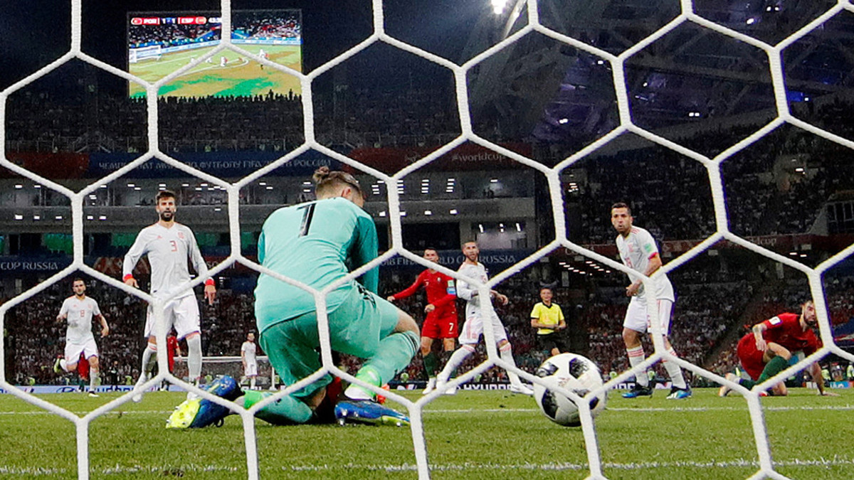 Soccer Football - World Cup - Group B - Portugal vs Spain - Fisht Stadium, Sochi, Russia - June 15, 2018 Portugal's Cristiano Ronaldo scores their second goal past Spain's David De Gea REUTERS/Murad Sezer TPX IMAGES OF THE DAY