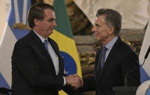 El presidente de Brasil, Jair Bolsonaro, junto con el de Argentina, Mauricio Macri.