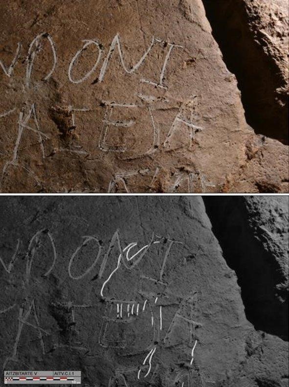 La pintada de dos nombres tapa la vista de un grabado prehistórico almacenado desde hace 27.000 años en las cuevas de Aitzbitarte, en el País Vasco