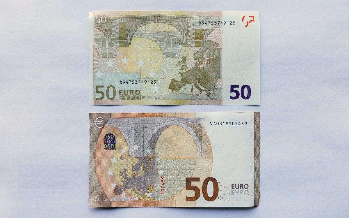 Imagen de un billete de 50 euros nuevo y otro antiguo