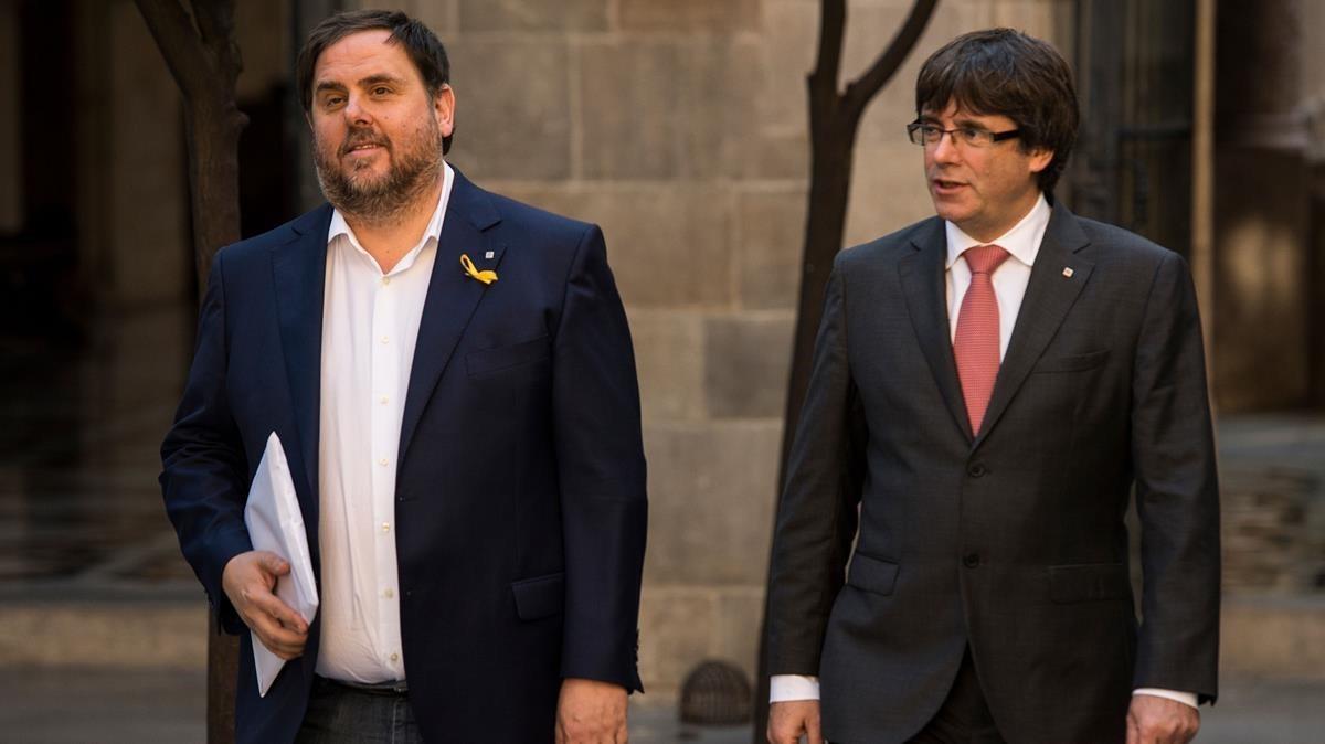 Oriol Junqueras y Carles Pugdemont en la Generalitat.