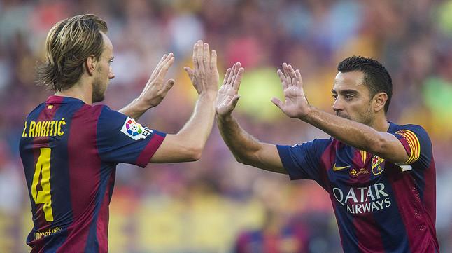 Xavi y Rakitic, en un partido en el Camp Nou.