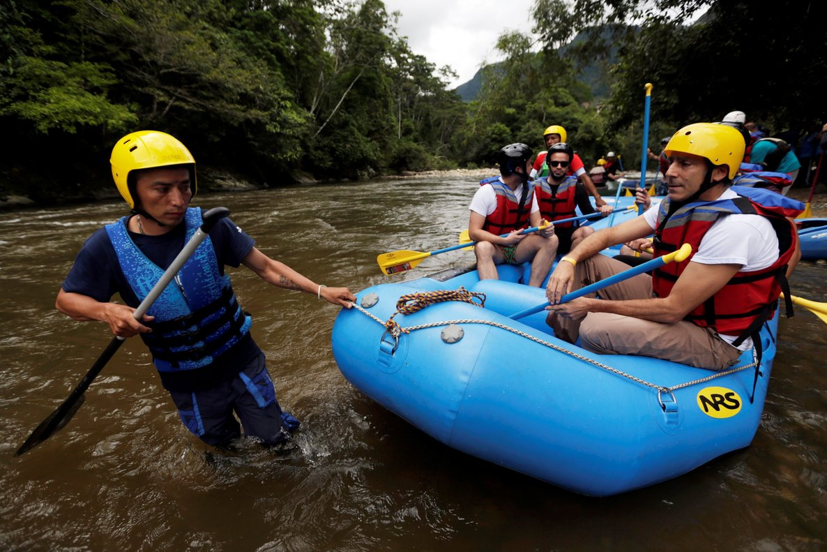 A group of the press and government representatives board an inflatable raft before practicing rafting in MiravalleColombia.REUTERS Luisa Gonzalez