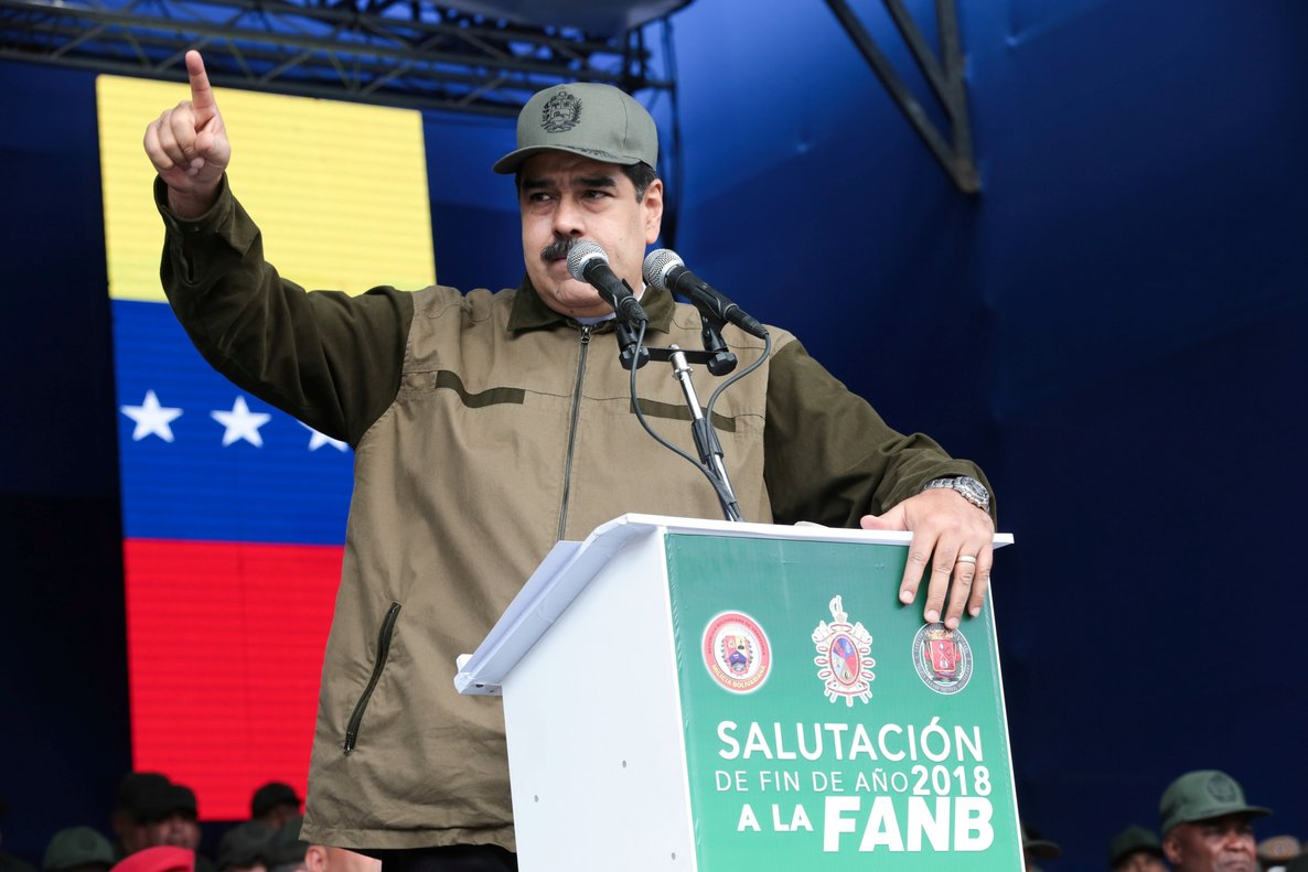 Venezuela s President Nicolas Maduro speaks during the end of the year ceremony with members of the Bolivarian National Armed Forces in CaracasVenezuela Miraflores Palace Handout via REUTERS