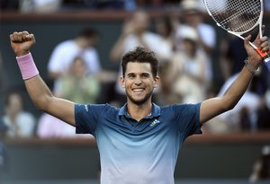 INDIAN WELLS, CA - MARCH 17: Dominic Thiem of Austria celebrates after defeating Roger Federer of Switzerland in the men's singles final on day fourteen of the BNP Paribas Open at the Indian Wells Tennis Garden on March 17, 2019 in Indian Wells, California. Kevork Djansezian/Getty Images/AFP (Photo by KEVORK DJANSEZIAN / GETTY IMAGES NORTH AMERICA / AFP)