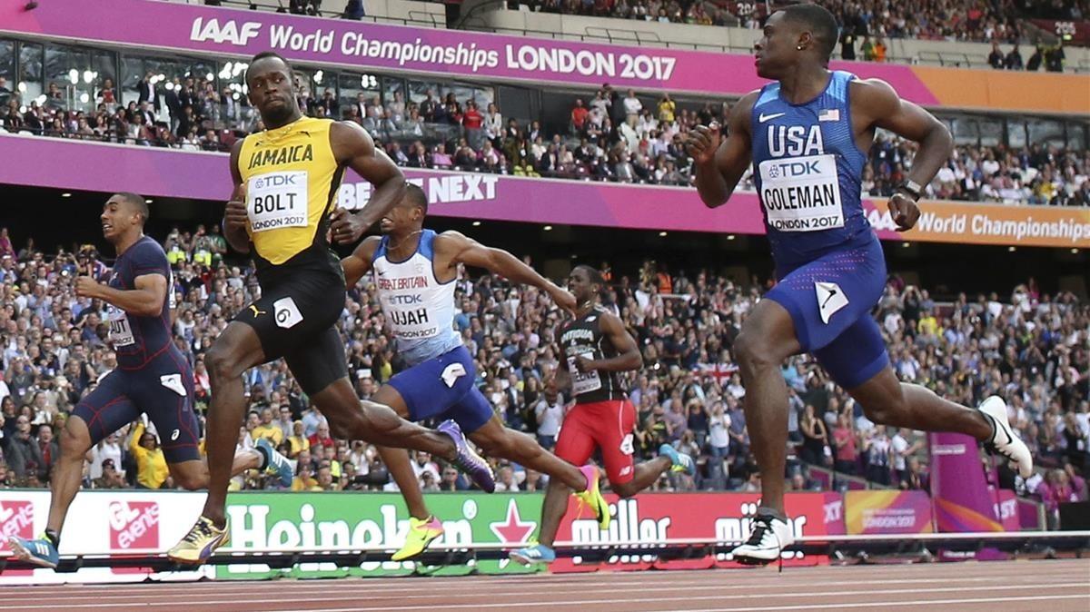 Coleman (derecha), junto a Bolt, en los Mundiales de Londres del 2017.