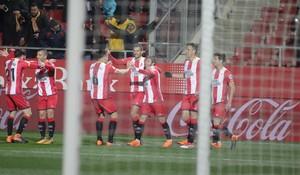 Los jugadores del Girona celebran el gol de Portu ante el Celta.