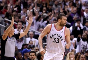 May 12, 2019; Toronto, Ontario, CAN; Toronto Raptors center Marc Gasol (33) reacts after making a basket against the Philadelphia 76ers in game seven of the second round of the 2019 NBA Playoffs at Scotiabank Arena. Mandatory Credit: Dan Hamilton-USA TODAY Sports