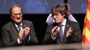 Quim Torra y Carles Puigdemont, en un acto en Bruselas en febrero del 2019.