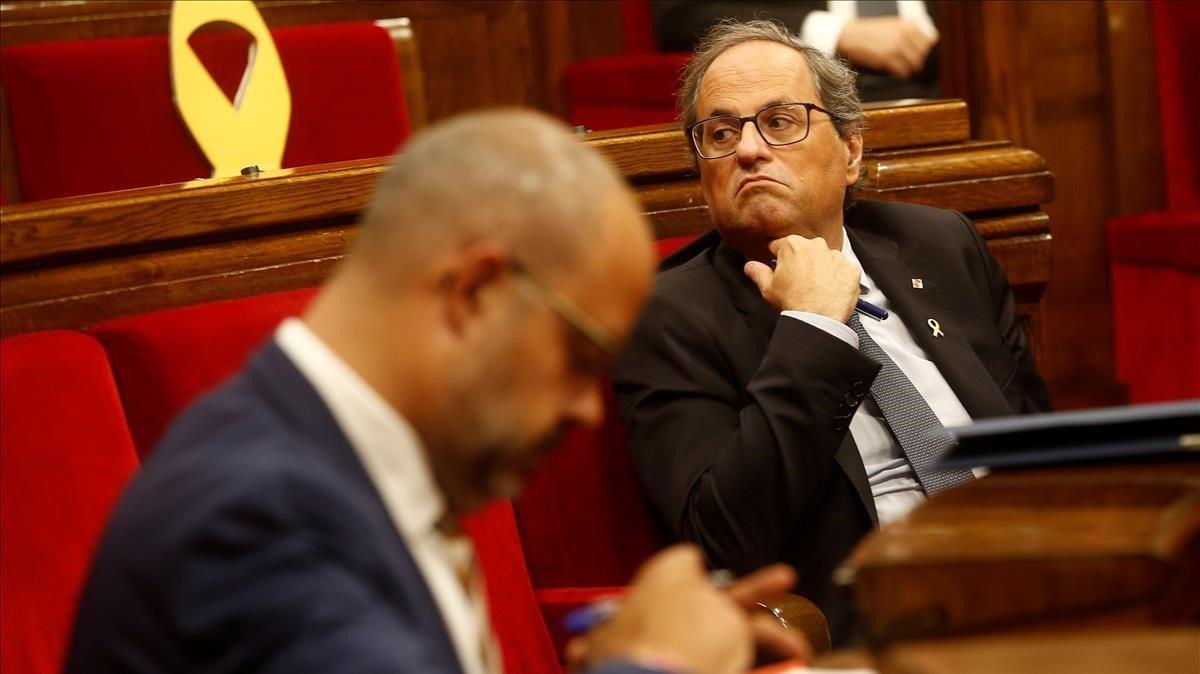 El presidente de la Generalitat,Quim Torra, y el 'conseller' de Interior, Miquel Buch