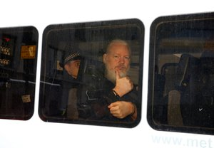 FILE PHOTO WikiLeaks founder Julian Assange is seen in a police van after was arrested by British police outside the Ecuadorian embassy in London Britain April 11 2019 REUTERS Henry Nicholls File Photo