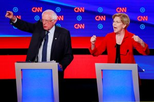 U S Senator Bernie Sanders and U S Senator Elizabeth Warren speak on the first night of the second 2020 Democratic U S presidential debate in Detroit Michigan U S July 30 2019 REUTERS Lucas Jackson TPX IMAGES OF THE DAY