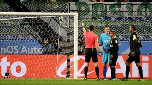 ecarrasco36620093 a referee l points to a penalty kick after speaking with t161214125256