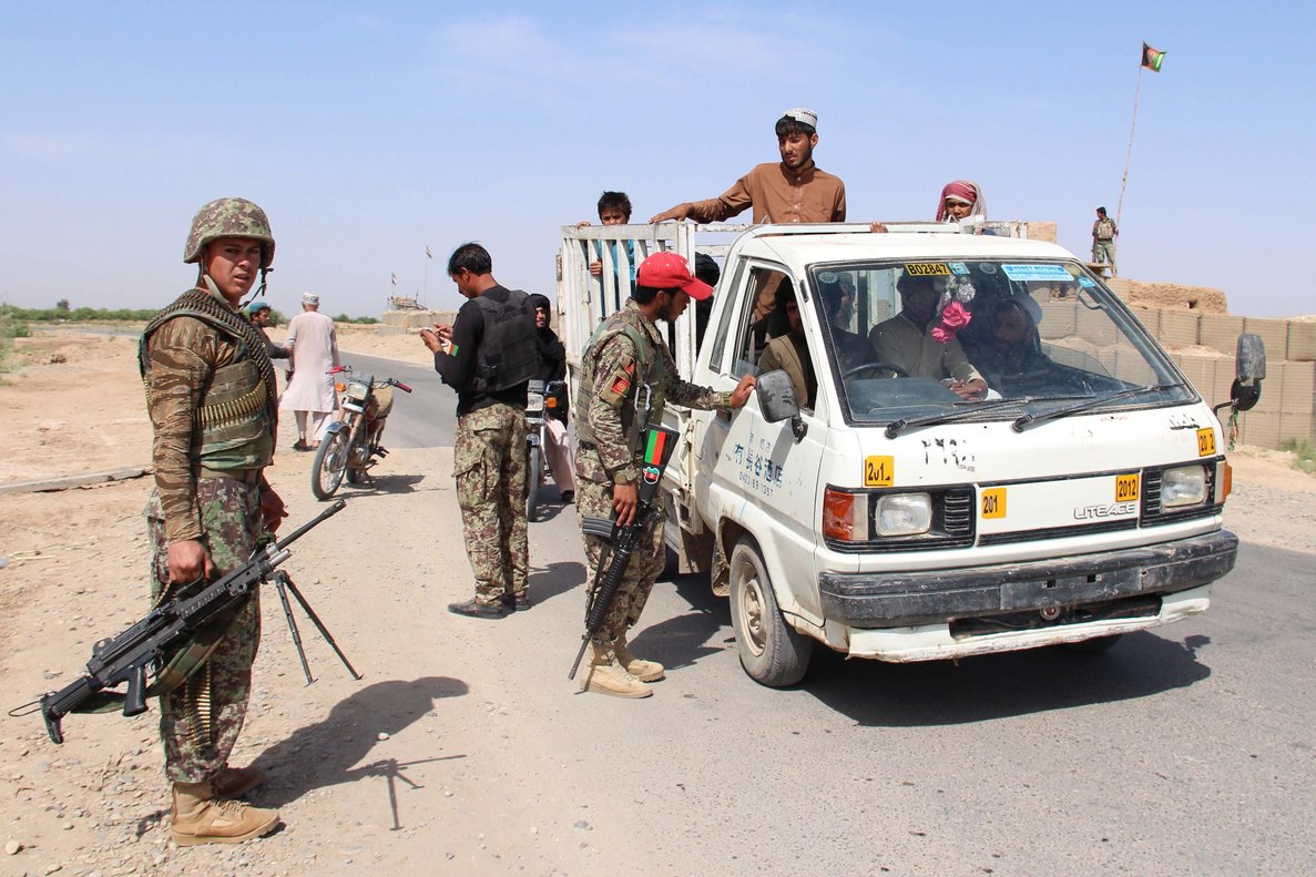 Afghan security officials check people and vehicles at a checkpoint in Helmand  Afghanistan  A top commander of the Taliban has been killed in Afghanistan s southern province of Helmand in a joint operation by Afghan and US Special Forces  EFE EPA WATAN YAR