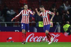 Saúl (d) celebra con Morata el segundo gol del Atlético.