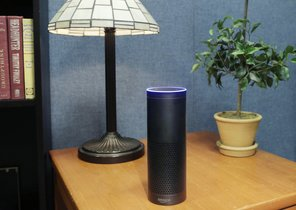 FILE - This July 29, 2015, file photo made in New York shows Amazons Echo, a digital assistant that continually listens for commands such as for a song, a sports score or the weather. Starting Thursday, March 17, 2016, Amazons voice assistant will tell you how well you slept and how much more exercise you need, at least if you have a Fitbit fitness tracker and an Alexa-compatible device, such as Amazons Echo speaker and Fire TV streaming devices. (AP Photo/Mark Lennihan, File)